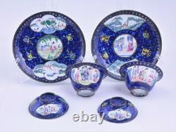 A pair of antique Chinese Canton enamel tea cups with saucers, 18thC