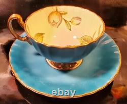 Aynsley Teacup & Saucer Turquoise Dogwood Flowers on Pale Yellow & Gold Exterior