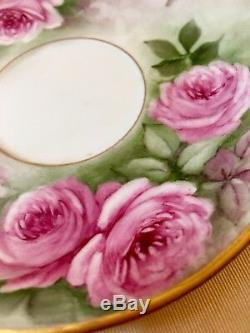 Delightful Limoges twin handle handpainted roses cup and saucer set