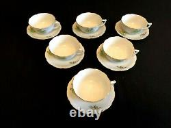 HEREND PORCELAIN HANDPAINTED TEA CUP AND SAUCER WITH ROSEHIP PATTERN (6pcs.)