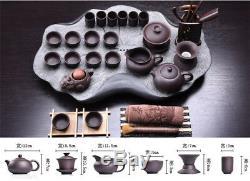 Real zisha tea set with tea tray black stone heavy tea table purple grit pot cup