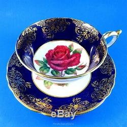 Signed Red Rose Center with a Cobalt and Gold Border Paragon Tea Cup and Saucer